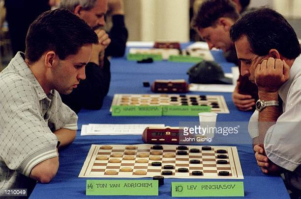 Ton van Adrichem takes on Lev Pinchasov in a game of draughts during the Mind Sports Olympiad at Olympia in London Mandatory Credit John Gichigi...
