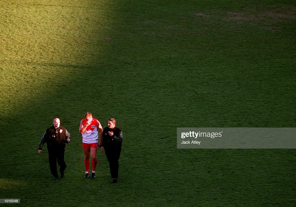 Tony Lockett #4 for the Sydney Swans leaves Waverley Park accompanied by two security guards following the round 22 Australian Football League match between Hawthorn and Sydney played at Waverley Park, Melbourne, Australia. This was the lastAustralian Football League match at the ground. It was also Lockett's last home and away game as he is retiring at the end of the season. Lockett holds the record for the most goals ever kicked in the history of the game. Mandatory Credit: Jack Atley/ALLSPORT