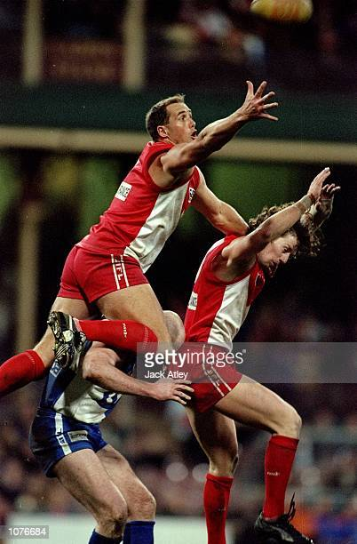 Tony Lockett of Sydney flies in for a mark during the AFL Round 19 match against the Kangaroos played at the SCG in Sydney Australia Mandatory Credit...