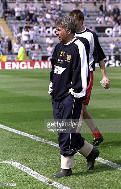 Wimbledon manager Egil Olsen wearing his wellies during the FA Carling Premiership match against Newcastle United at St James Park in Newcastle...