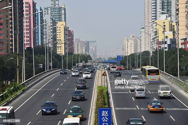 BEIJING Aug 20 2015 Vehicles run on a street in Beijing capital of China Aug 20 2015 Beijing began to ban half the cars from the road from Aug 20 to...