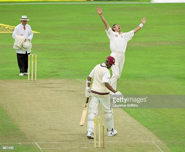 Andrew Caddick of England takes the wicket of Courtney Walsh of the West Indies during the Fourth Test match played at Headingley in Leeds England...