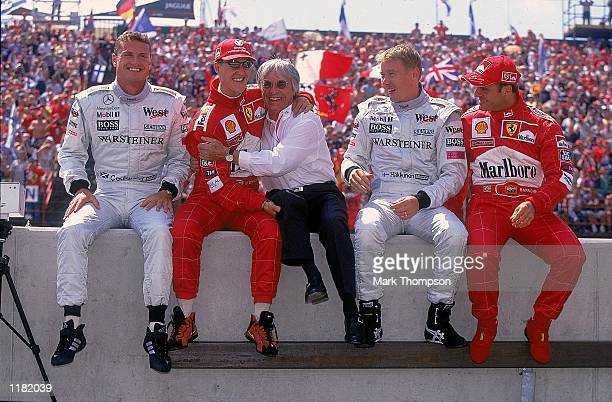 David Coulthard of Great Britain and West McLarenMercedes Michael Schumacher of Germany and Ferrari Bernie Ecclestone of the FIA Mika Hakkinen of...