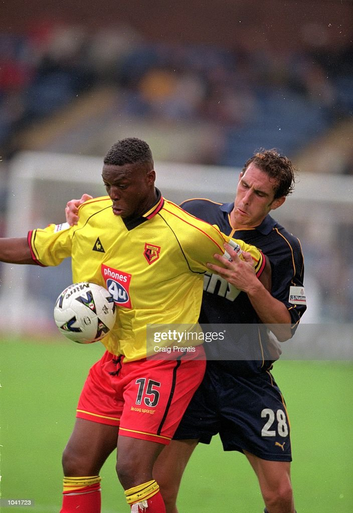 Gifton Noel-Williams of Watford holds the ball up as Peter Hawkins of Wimbledon closes in during the Nationwide League Division One match at Selhurst Park, in London. The match ended in a 0-0 draw. \ Mandatory Credit: Craig Prentis /Allsport