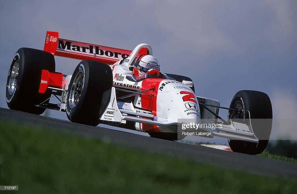 Gil de Ferran of Brazil who drives a Honda Reynard 2KI for Marlboro Team Penske comes around a corner during practice of the Miller Lite 200 part of...