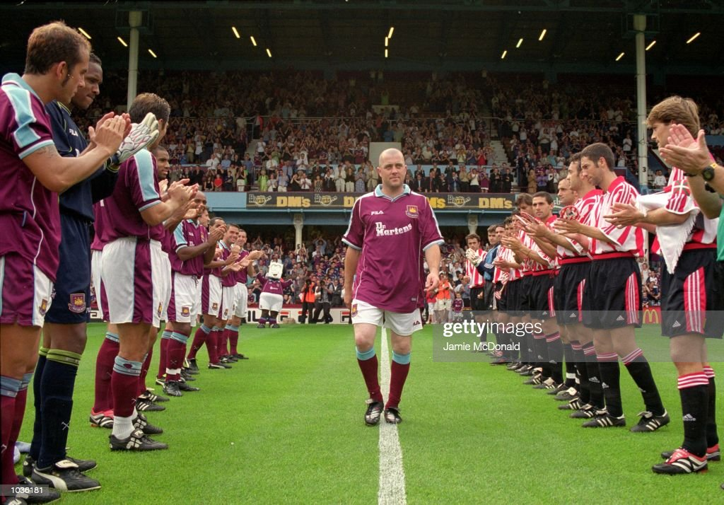 Julian Dicks is applauded by the two teams before his Benefit match between West Ham United and Athletic Bilbao at Upton Park in London. \ Mandatory Credit: Jamie McDonald /Allsport