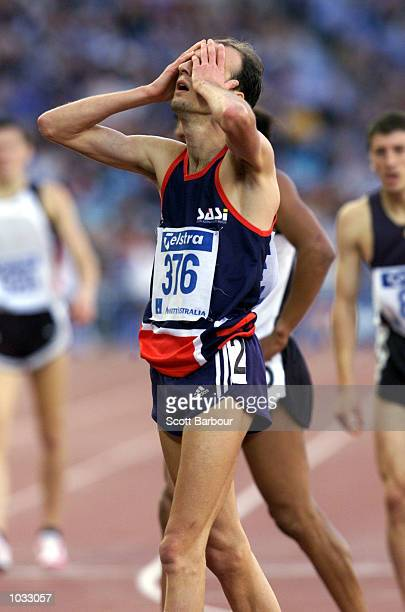 Nick Howarth of Australia holds his head at the end of the 1500 metres mens race which he won after Craig Mottram of Australia led but fell at the...