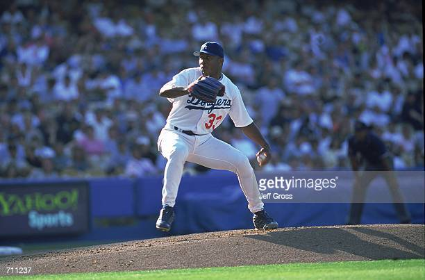 Pitcher Carlos Perez of the Los Angeles Dodgers throws the ball during the game against the Milwaukee Brewers at Dodger Stadium in Los Angeles...