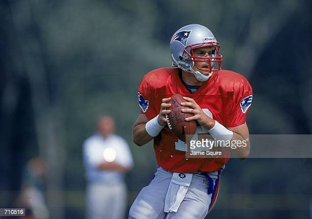 Quarterback Tom Brady of the New England Patriots looks to pass the ball during the Patriots Training Camp at Bryant College in Smithfield Rhode...
