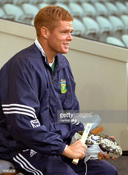 South African Captain Shaun Pollock cleans his boots on Colonial Stadium venue for the Super Challenge 2000 one day cricket series beginning...