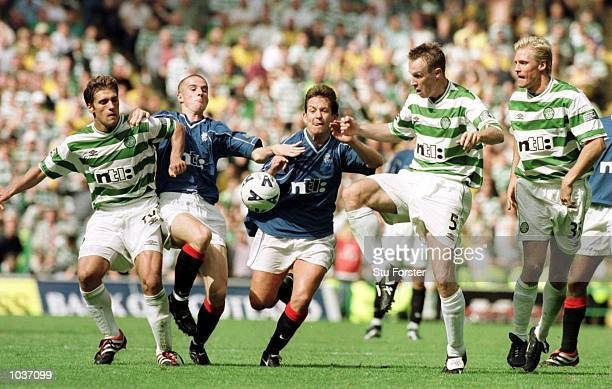 Stilian Petrov of Celtic battles with Barry Ferguson and Billy Dodds of Rangers and Joos Valgaeren and Johan Mjallby of Celtic during the Glasgow...