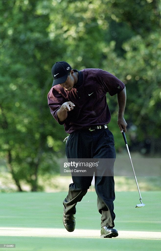 Tiger Woods describes how his ball needs to roll during the PGA Championship part of the PGA Tour at the Valhalla Golf Club in Louisville...