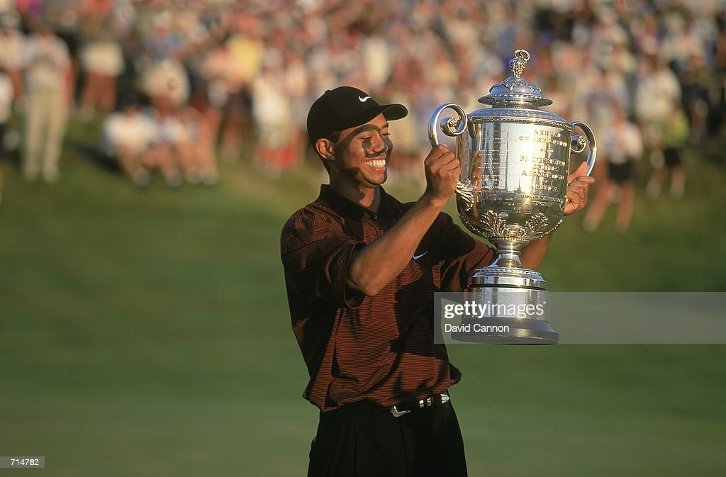 Tiger Woods holds up his trophy after winning the PGA Championship part of the PGA Tour at the Valhalla Golf Club in Louisville KentuckyMandatory...