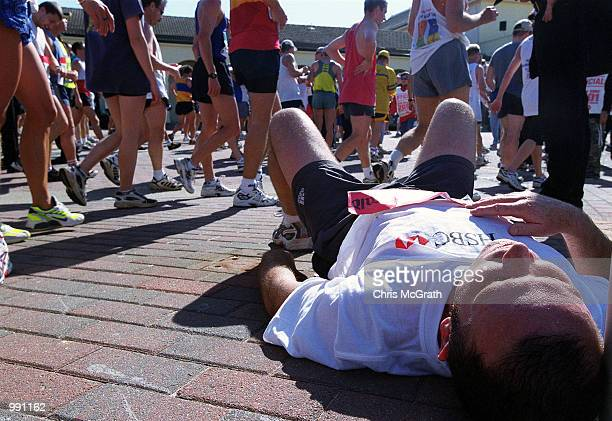 A City to Surf competitor lies exhausted at the finish line at the 2001 Sun Herald City to Surf marathon held in Sydney Australia Mandatory Credit...