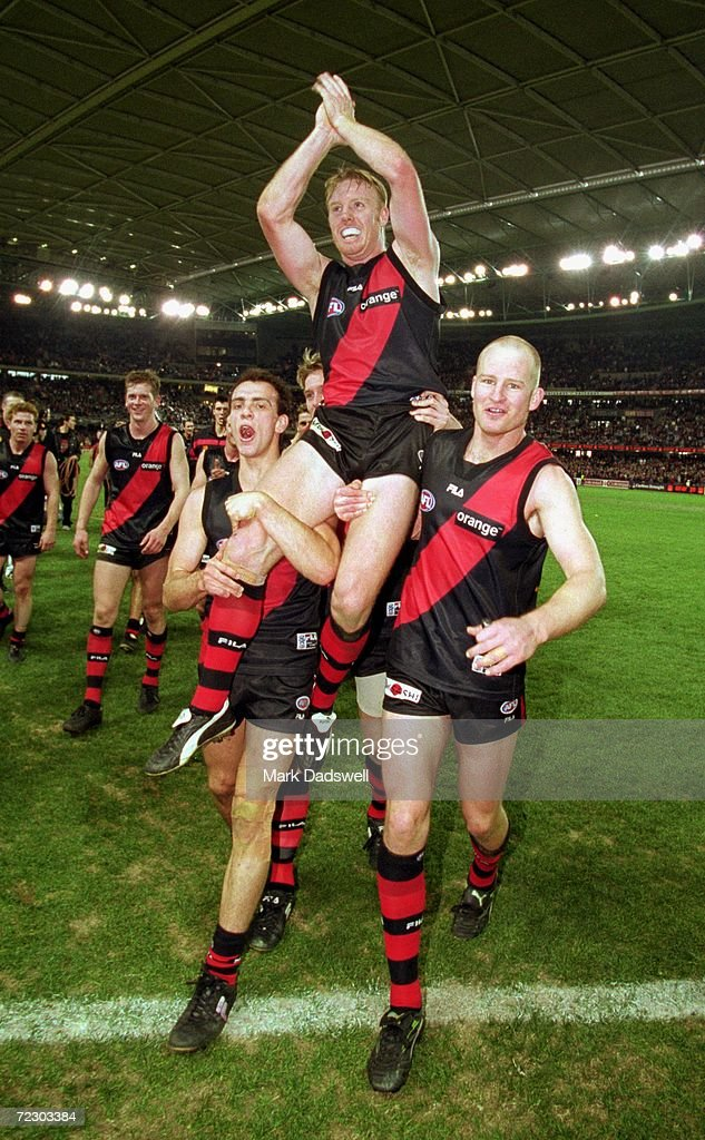 Adam Ramanauskas Paul Barnard and Sean Wellman for Essendon celebrate the teams win over Sydney during the round 19 AFL match played between the...