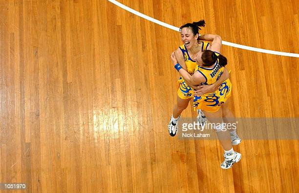Captain Liz Ellis and team mate Broadbent of the Swifts celebrate victory in the Commonwealth Bank Trophy Netball Grand Final between the Sydney...