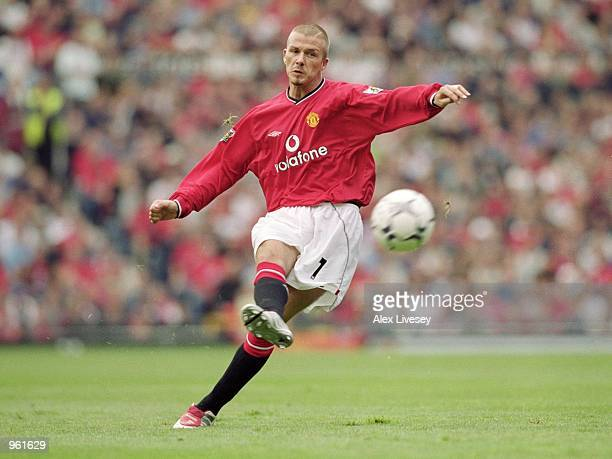 David Beckham of Manchester United takes a trademark freekick during the FA Barclaycard Premiership match against Fulham played at Old Trafford in...