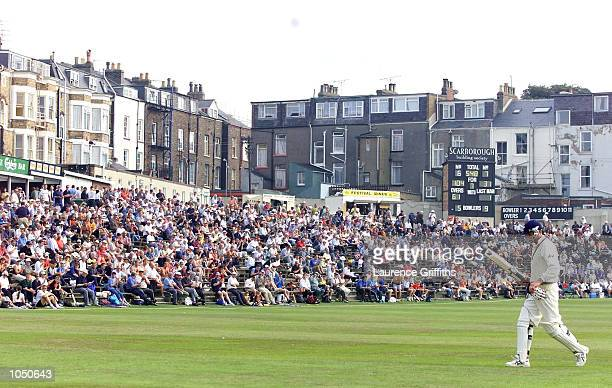 David Byas of yorkshire walks off to the delight of the Scarborough crowd after his century during the Cricinfo Championship game between Yorkshire...