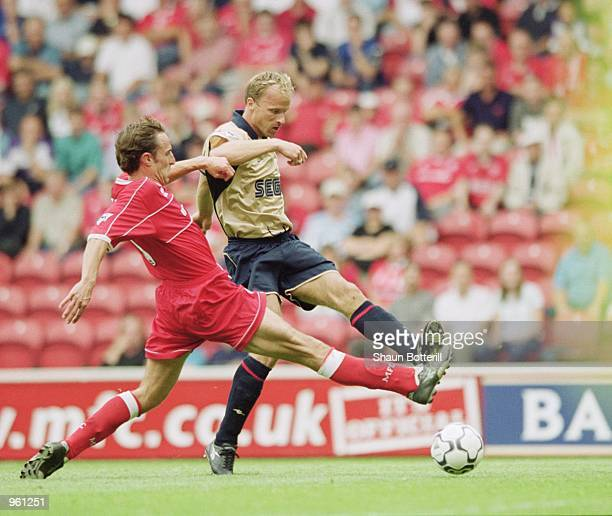 Dennis Bergkamp of Arsenal beats Gareth Southgate of Middlesbrough to score during the FA Barclaycard Premiership match at the Riverside Stadium in...
