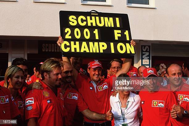 Ferrari driver Michael Schumacher celebrates after the Formula One Hungarian Grand Prix held at the Hungaroring in Budapest Hungary Michael...