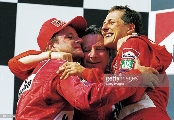 Ferrari driver Rubens Barrichello sporting director Jean Todt and Michael Schumacher celebrate after the Formula One Hungarian Grand Prix held at the...