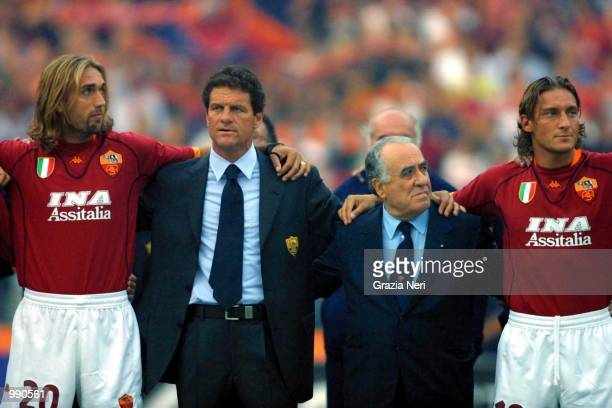Gabriel Batistuta coach Fabio Capello president Franco Sensi and captain Francesco Totti of Roma celebrate their league title at the preseason...