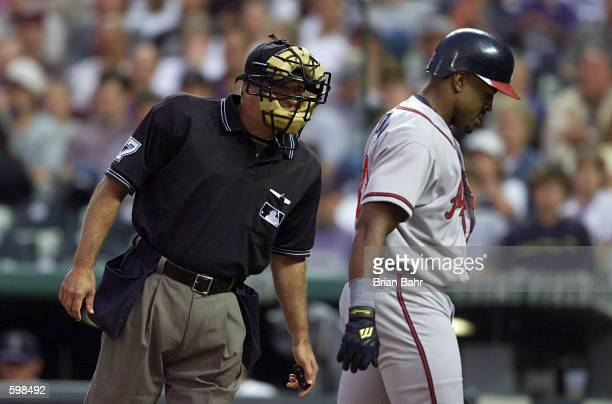 Home plate umpire John Hirschbeck appears to dare Brian Jordan of the Atlanta Braves to make a comment about his called third strike in a game...