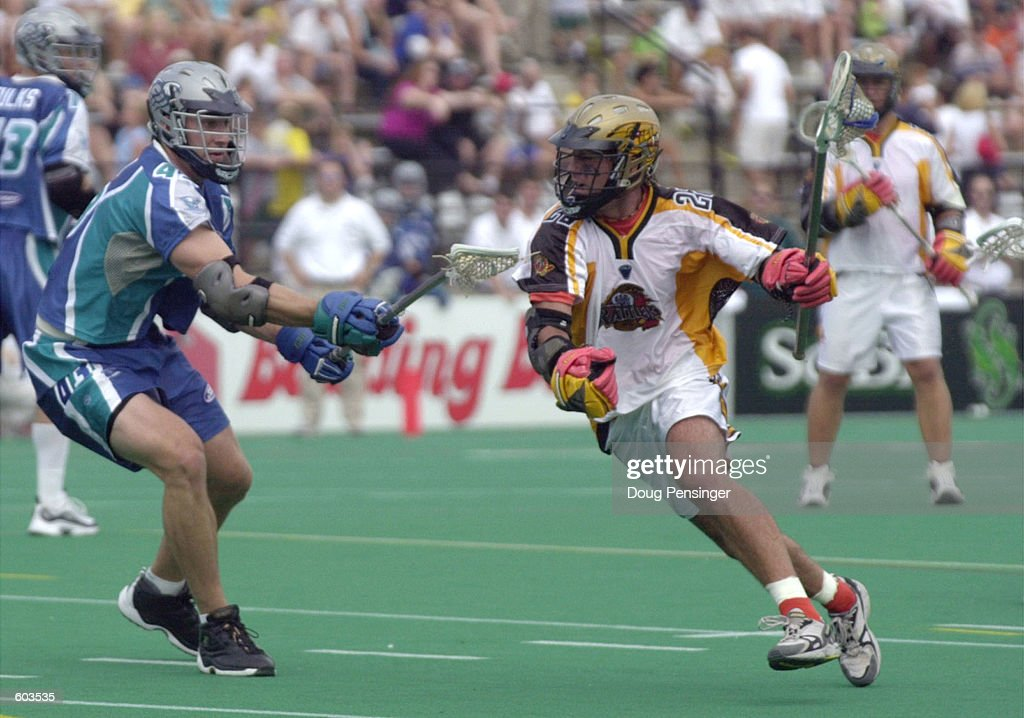 Hugh Donovan of the Baltimore Bayhawks defends as Ryan Powell of the Rochester Rattlers makes his way toward the goal during their Major League...