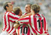 Kevin Phillips is mobbed by his team mates after scoring a goal during the FA Barclaycard Premiership North East derby match against Newcastle United...