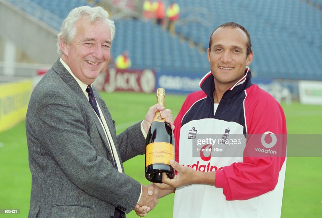 Man of the match Mark Butcher of England is presented with a bottlle of Champagne after the 4th Ashes Test Match between England and Australia played...