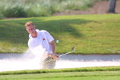 Mark Warren of the Great Britain and Ireland team plays from the sand at the 5th hole during final practice for the 2001 Walker Cup Match at the...