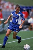 Mia Hamm of the Washington Freedom runs with the ball during the WUSA game against the New York Power at the Navy Marine Corps Memorial Stadium in...