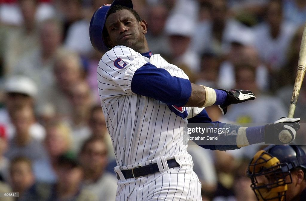 Outfielder Sammy Sosa #21 of the Chicago Cubs swings at a pitch so hard that he loses his batting helmet in the seventh inning of a game against the Milwaukee Brewers at Wrigley Field in Chicago, Illinois. The Brewers won 8-1. DIGITAL IMAGE Mandatory Credit: Jonathan Daniel/ALLSPORT