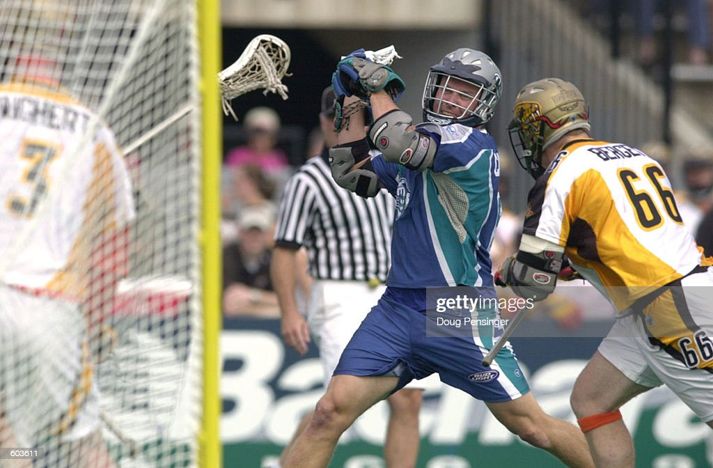 Paul Cantabene of the Baltimore Bayhawks takes a shot on goal past the defense of Jake Bergey of the Rochester Rattlers during their Major League...