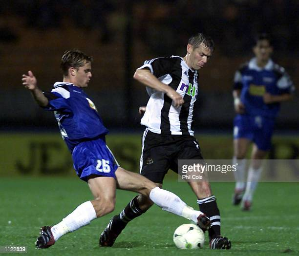 Robert Lee of Newcastle is tackled by Jerone Rotren of Troyes during the Intertoto Cup Final First Leg between Troyes and Newcastle United at the...