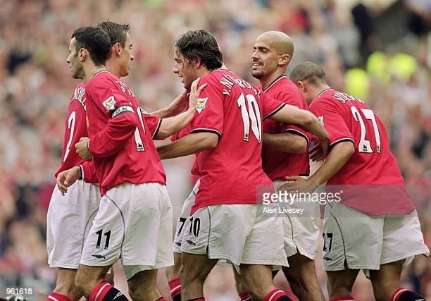 Ruud van Nistelrooy of Manchester United celebrates scoring his first goal in the league with teammates Ryan Giggs Gary Neville Juan Sebastian Veron...
