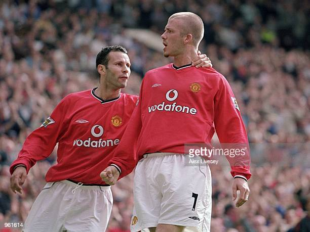 Ryan Giggs and David Beckham of Manchester United celebrate during the FA Barclaycard Premiership match against Fulham played at Old Trafford in...