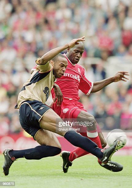 Thierry Henry of Arsenal and Ugo Ehiogu of Middlesbrough challenge for the ball during the FA Barclaycard Premiership match played at the Riverside...