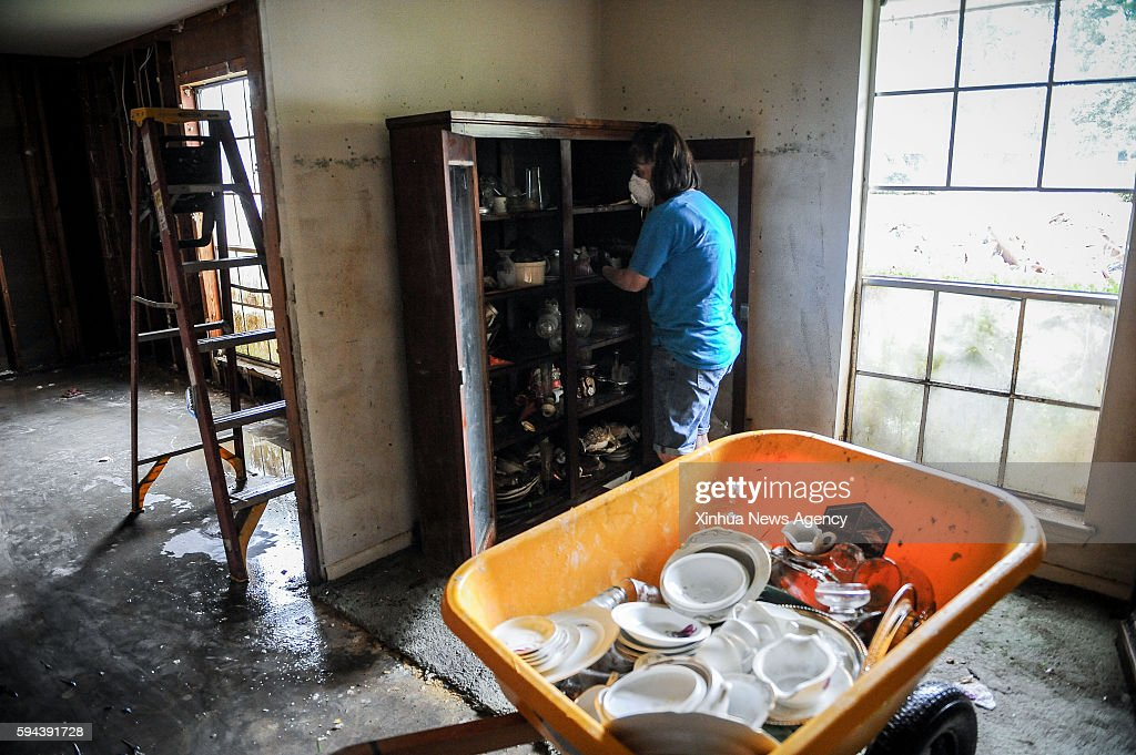 ROUGE Aug 22 2016 A resident tides up a closet at a house in Baton Rouge Louisiana Aug 22 2016 Severe flooding caused by heavy rain hit the southern...