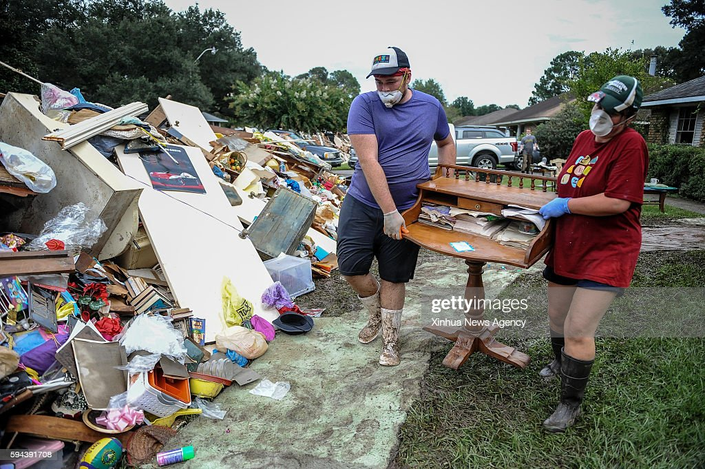 ROUGE Aug 22 2016 Residents throw furniture damaged in floods in Baton Rouge Louisiana Aug 22 2016 Severe flooding caused by heavy rain hit the...