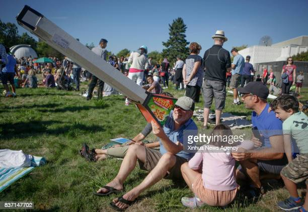 VANCOUVER Aug 22 2017 A man carries a homemade pinhole viewer to view solar eclipse in Vancouver Canada on Aug 21 2017 Thousands of people gathered...