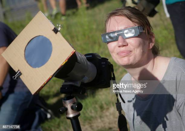 VANCOUVER Aug 22 2017 A resident takes photos of solar eclipse in Vancouver Canada on Aug 21 2017 Thousands of people gathered at the HR Macmillan...