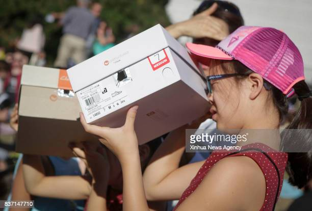 VANCOUVER Aug 22 2017 Children use homemade pinhole viewfinders to view solar eclipse in Vancouver Canada on Aug 21 2017 Thousands of people gathered...