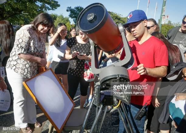 VANCOUVER Aug 22 2017 People view the projected image of solar eclipse created by a telescope in Vancouver Canada on Aug 21 2017 Thousands of people...