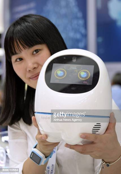 BEIJING Aug 23 2017 A staff shows a voice assistant robot during the World Robot Conference 2017 in Beijing capital of China Aug 23 2017 The fiveday...