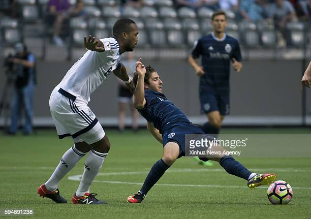 VANCOUVER Aug 24 2016 Vancouver Whitecaps' Kendall Watson left vies with Sporting Kansas City's Connor Hallisey during a Group C match of the...