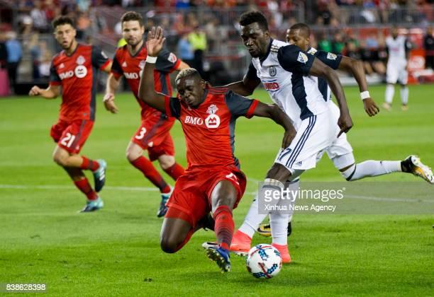 Chris Mavinga of Toronto FC vies with CJ Sapong of Philadelphia Union during the 2017 Major League Soccer match at BMO Field in Toronto Canada Aug 23...
