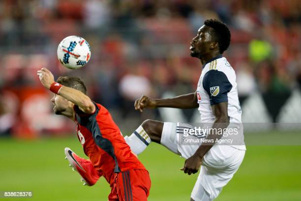 Drew Moor of Toronto FC vies with CJ Sapong of Philadelphia Union during the 2017 Major League Soccer match at BMO Field in Toronto Canada Aug 23...