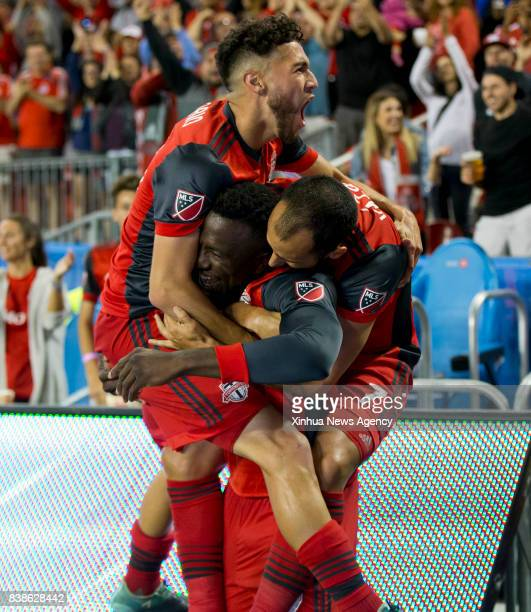 Jozy Altidore of Toronto FC celebrates scoring with teammates during the 2017 Major League Soccer match against Philadelphia Union at BMO Field in...