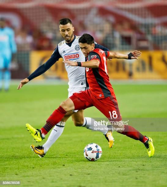 Marco Delgado of Toronto FC vies with Haris Medunjanin of Philadelphia Union during the 2017 Major League Soccer match at BMO Field in Toronto Canada...
